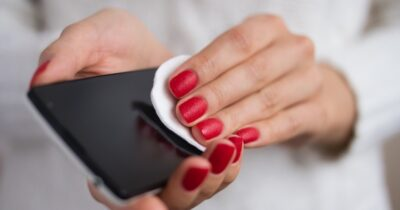Image of woman cleaning a phone