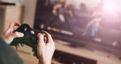 Image of man playing a console game