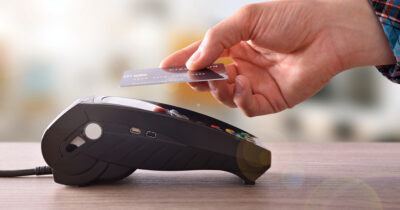 Hand making a contactless payment