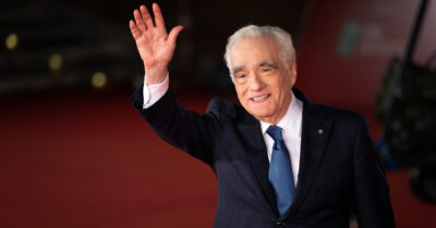 Martin Scorsese waving at Cannes