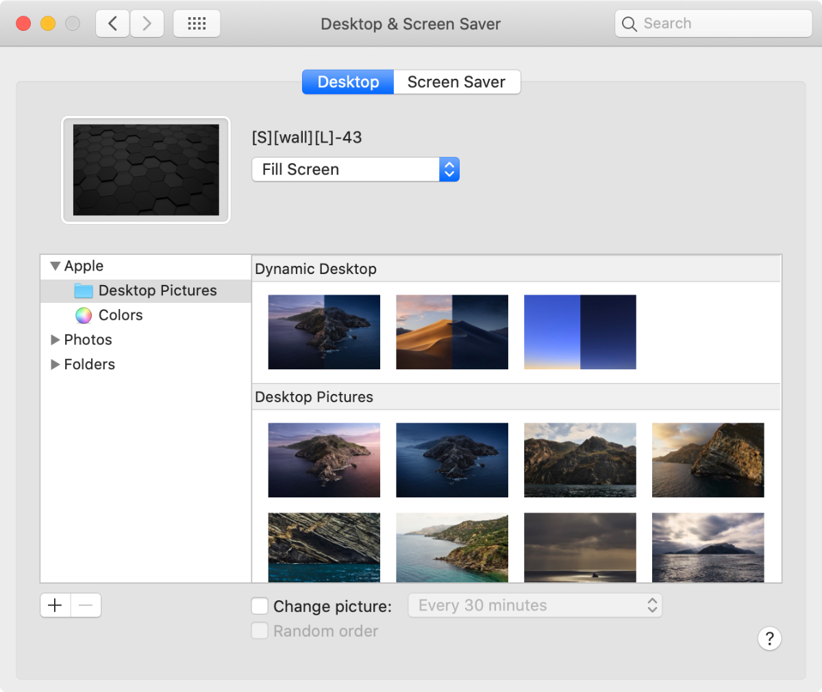 image of system preferences on macOS to change home screen wallpaper.
