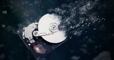 A hard disk drive being disintegrated.