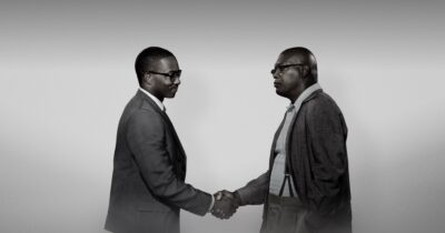 Image of Samuel L. Jackson and Anthony Mackie Shaking hands in The Banker.