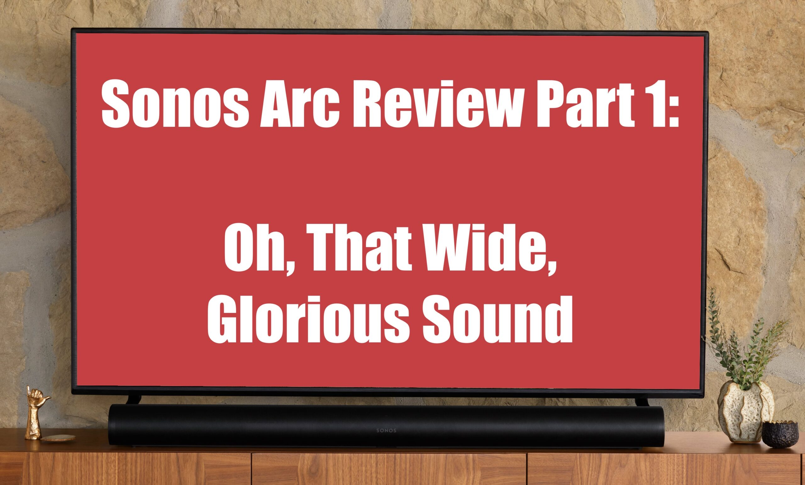 Sonos Arc below TV with Text: Sonos Arc Review Part 1 Oh That Wide Glorious Sound