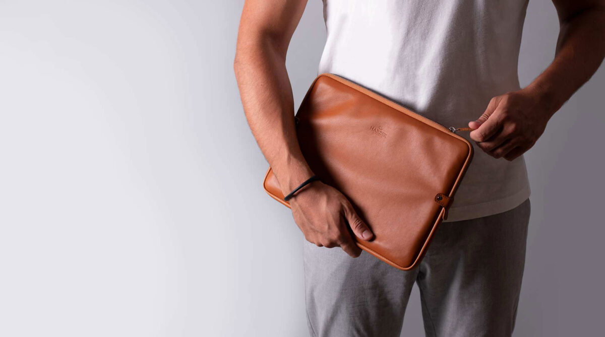 Man carrying Harber London laptop sleeve