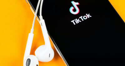 iPhone with TikTok logo and EarPods