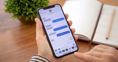 Woman using imessage on an iPhone X