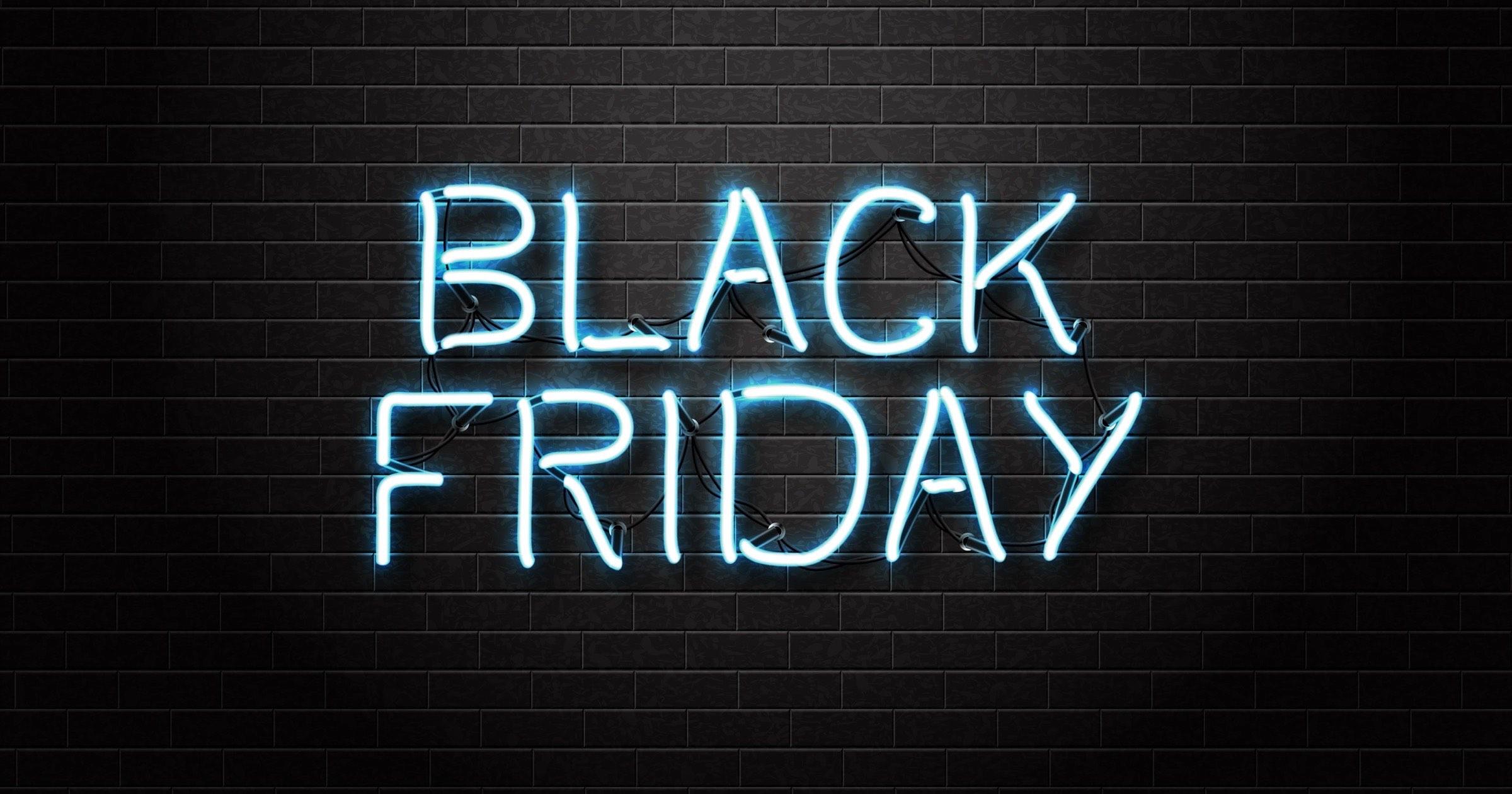 Black Friday text on black brick background.