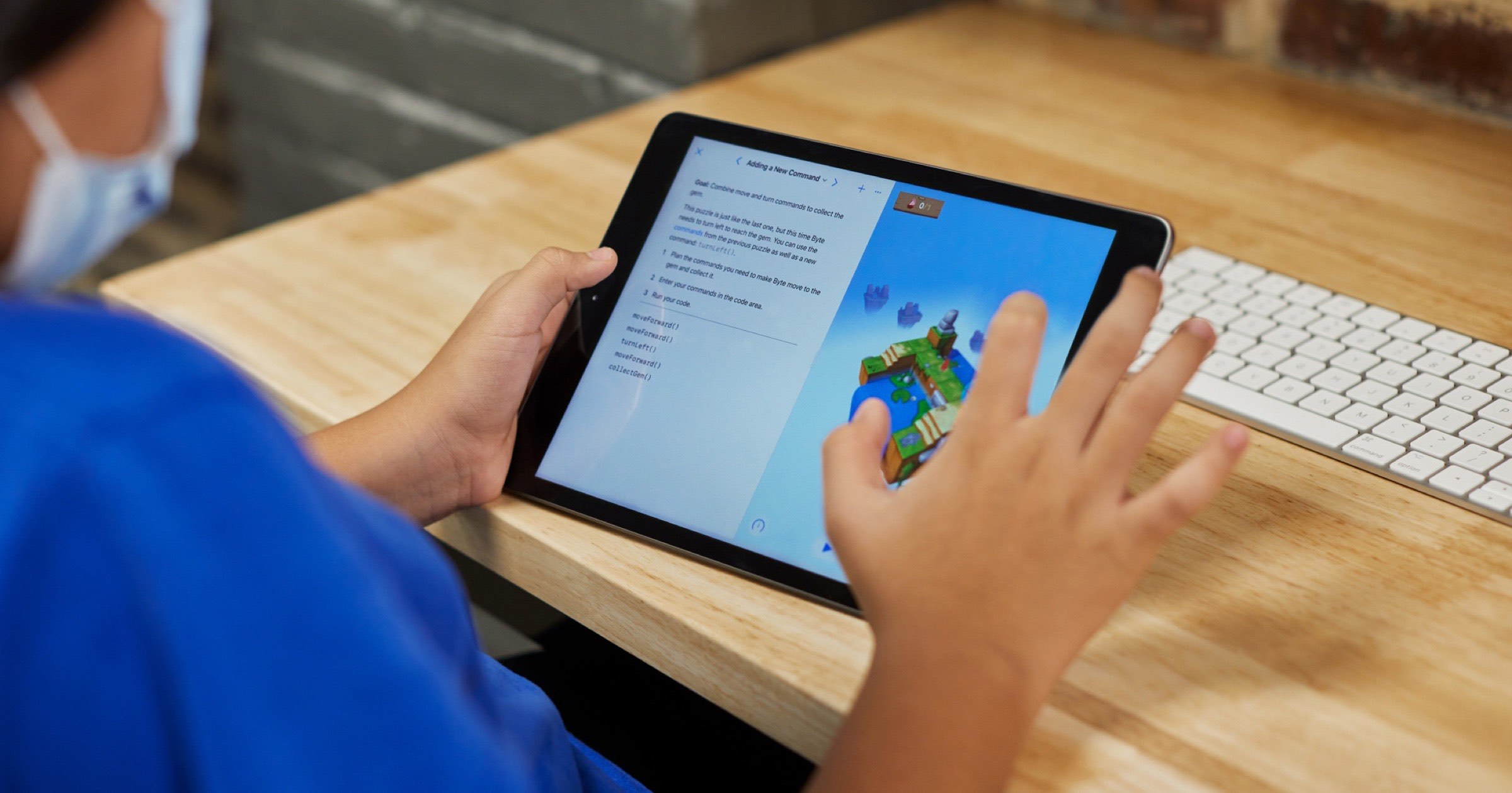 Kid using an iPad to play with Apple's swift playgrounds app.