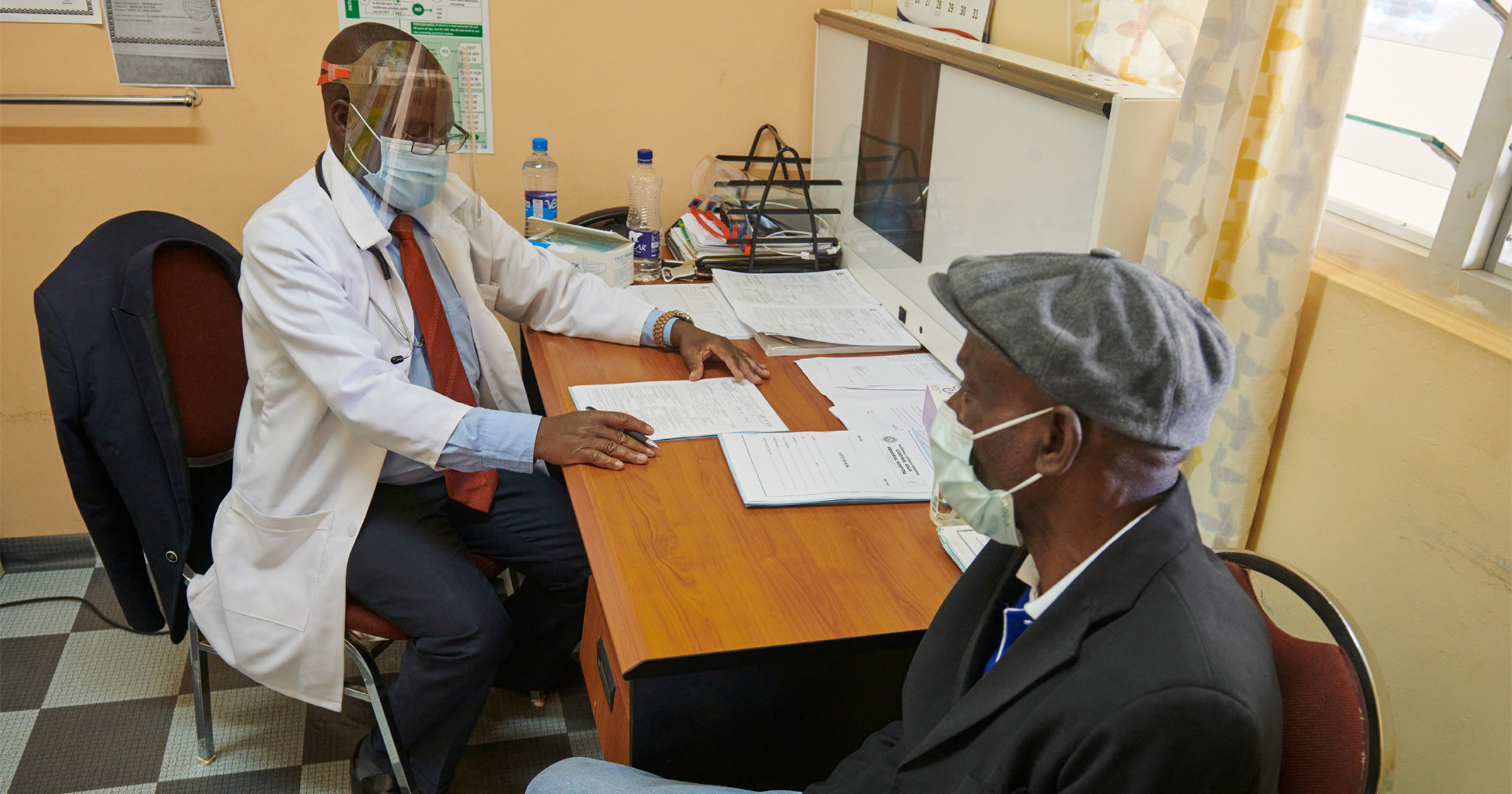 Doctor and patient using Apple PPE for COVID-19 at Zambia clinic