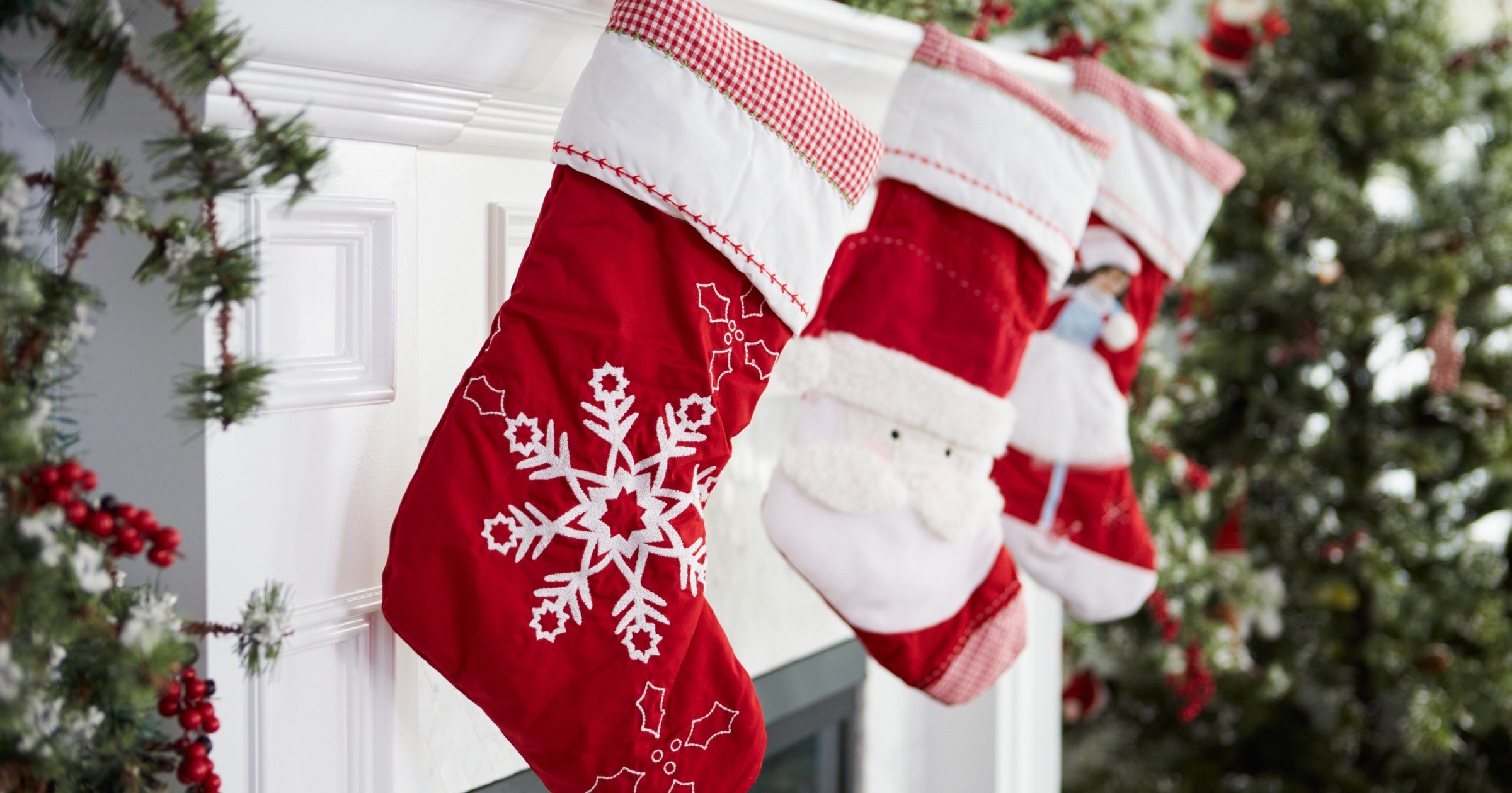 Christmas stockings hanging on a fireplace.