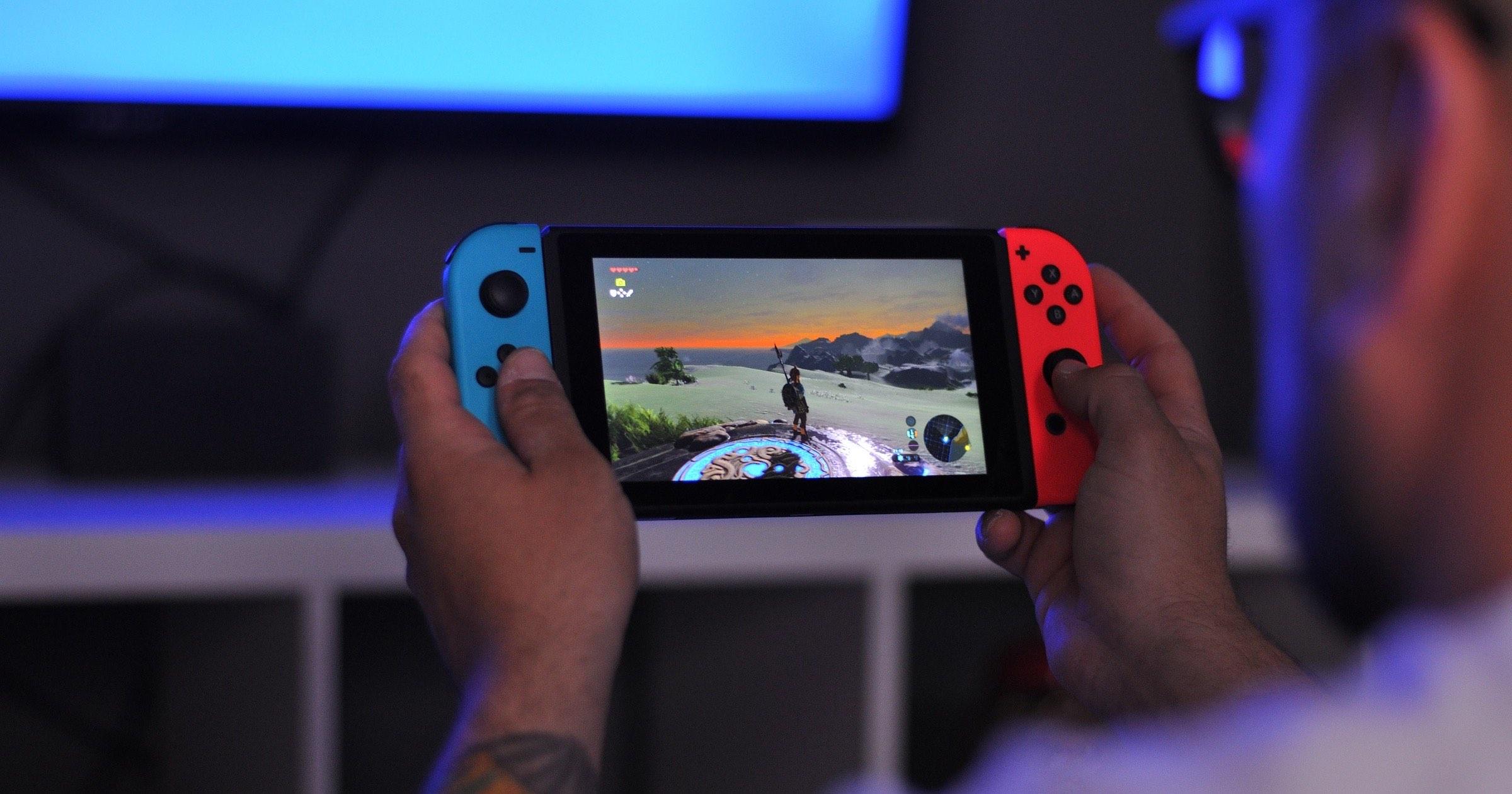 Man playing Nintendo switch