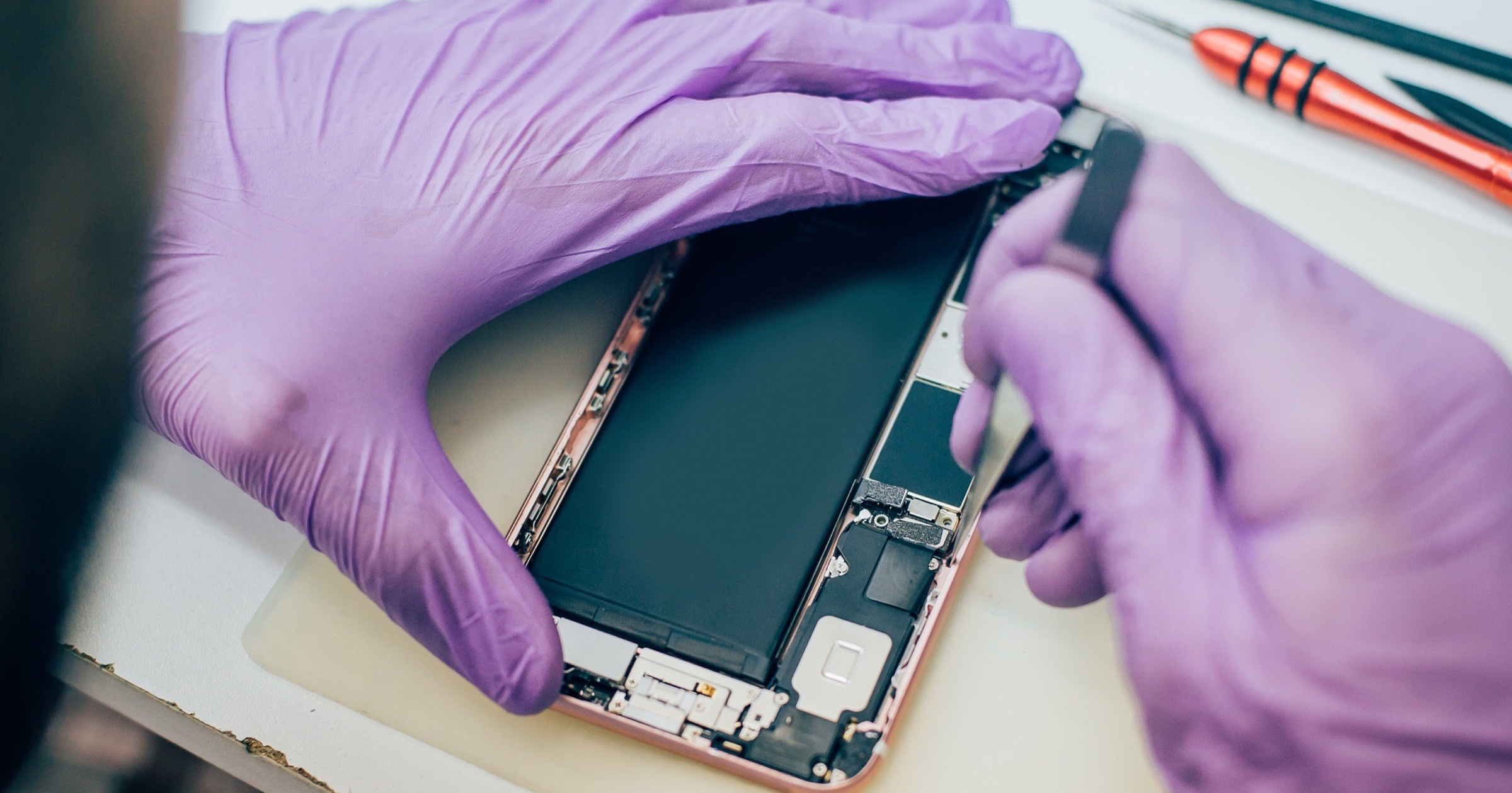 Technician repairs smartphone