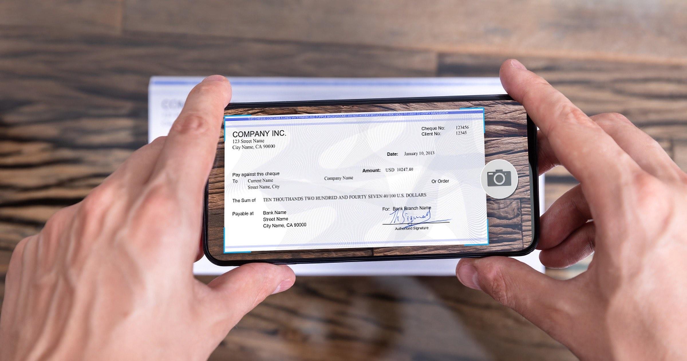 Man cashing check using smartphone