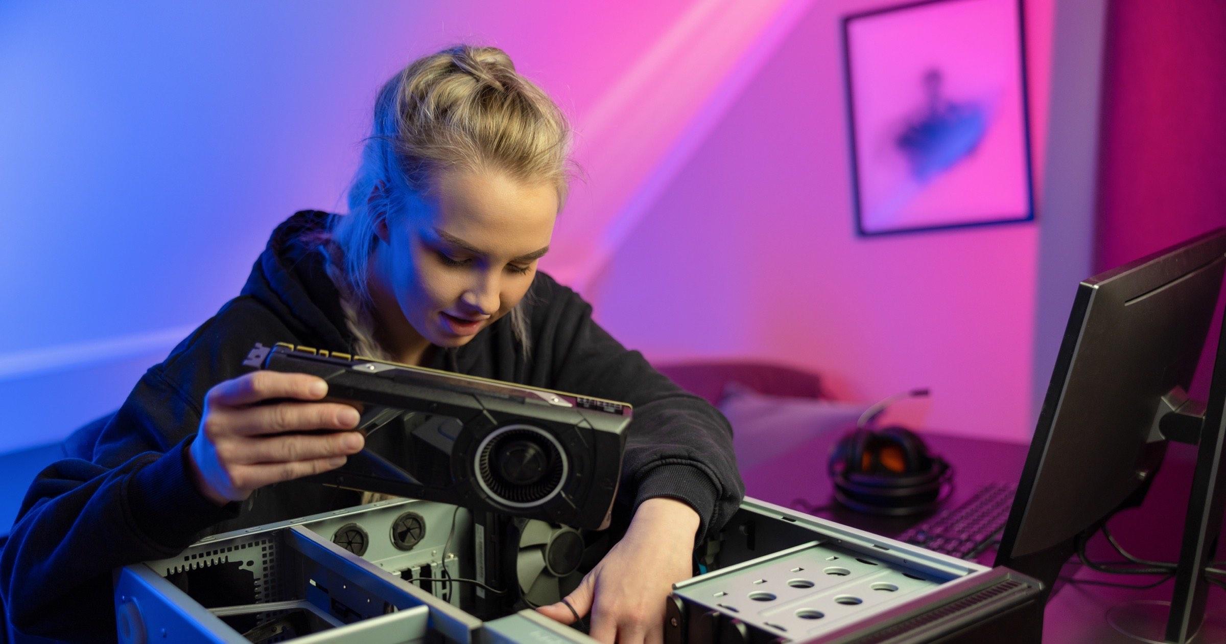 Woman installing GPU in PC