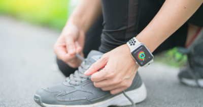 Apple Watch Fitness woman tying sport shoes laces