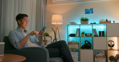 Asian man controlling smarthome devices