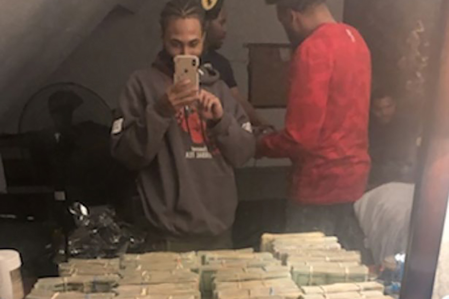 Robbery crew posing with stolen cash