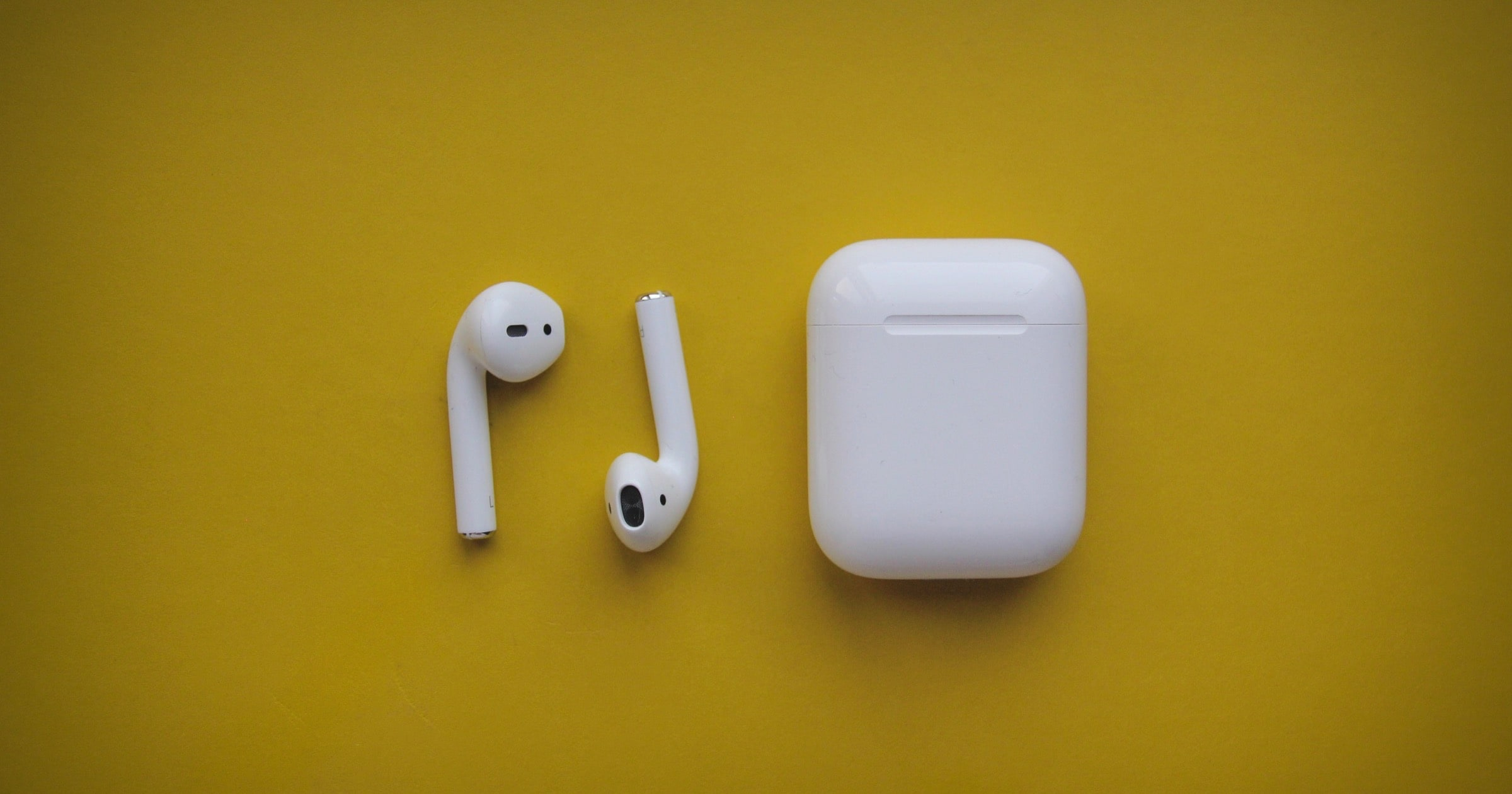 airpods on yellow background