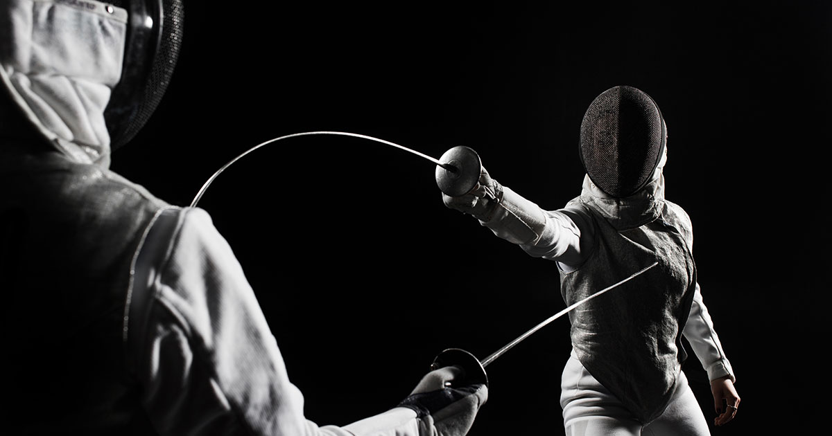 Two fencers fencing